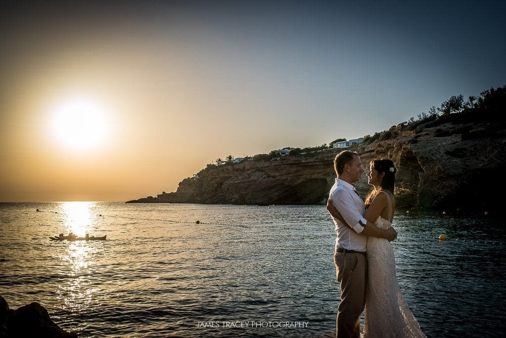 wedding couple in from of setting Ibiza sun