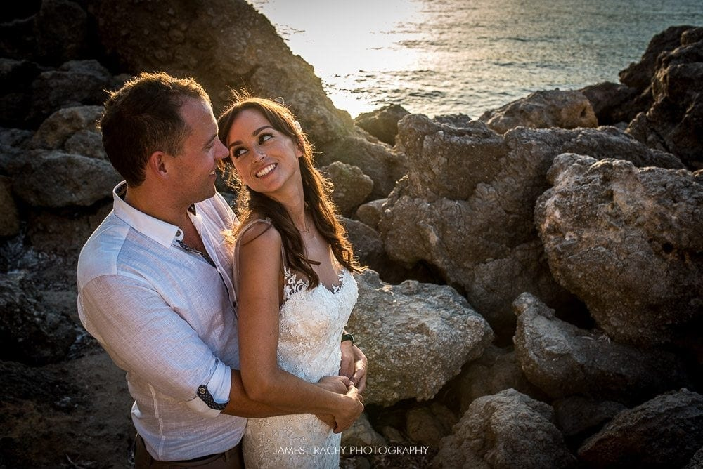wedding couple in rocks in ibiza