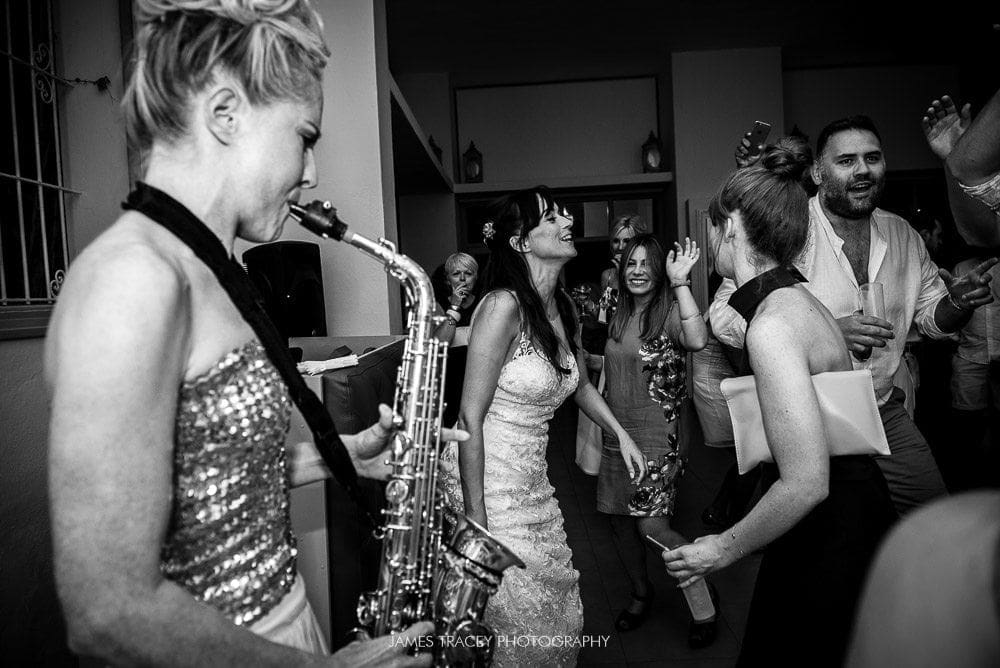 lovely laura on sax at ibiza wedding