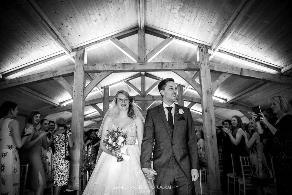 bride and groom leaving colshaw hall wedding