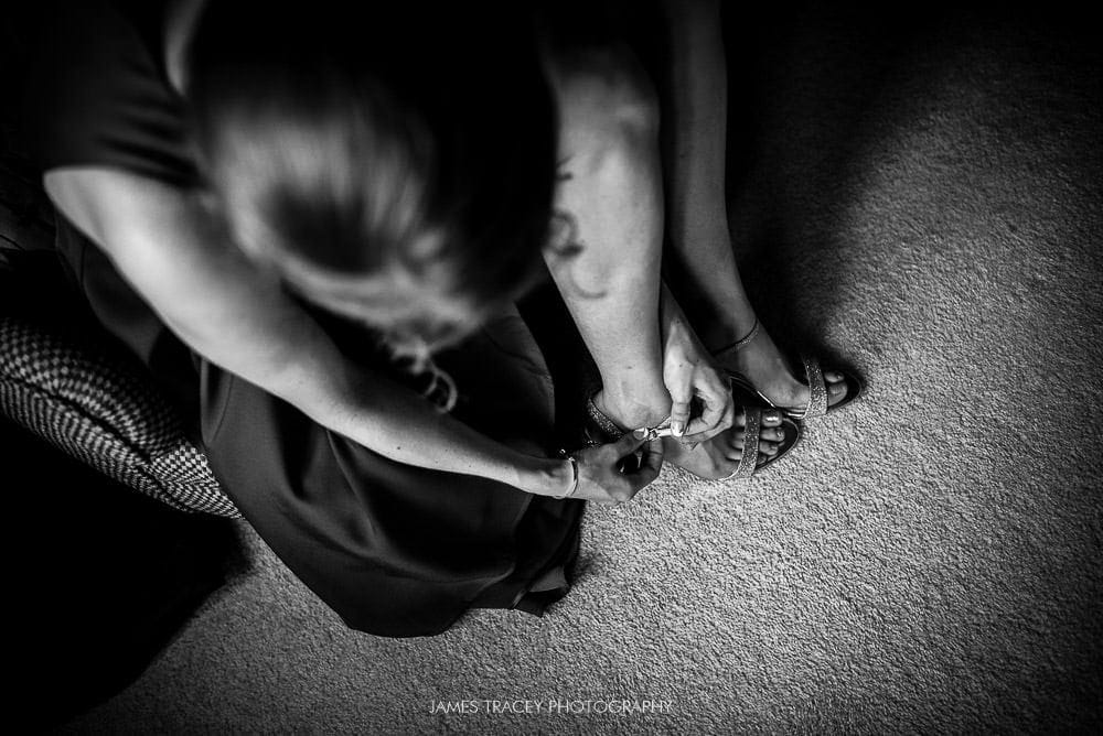 bridesmaid putting shoes on