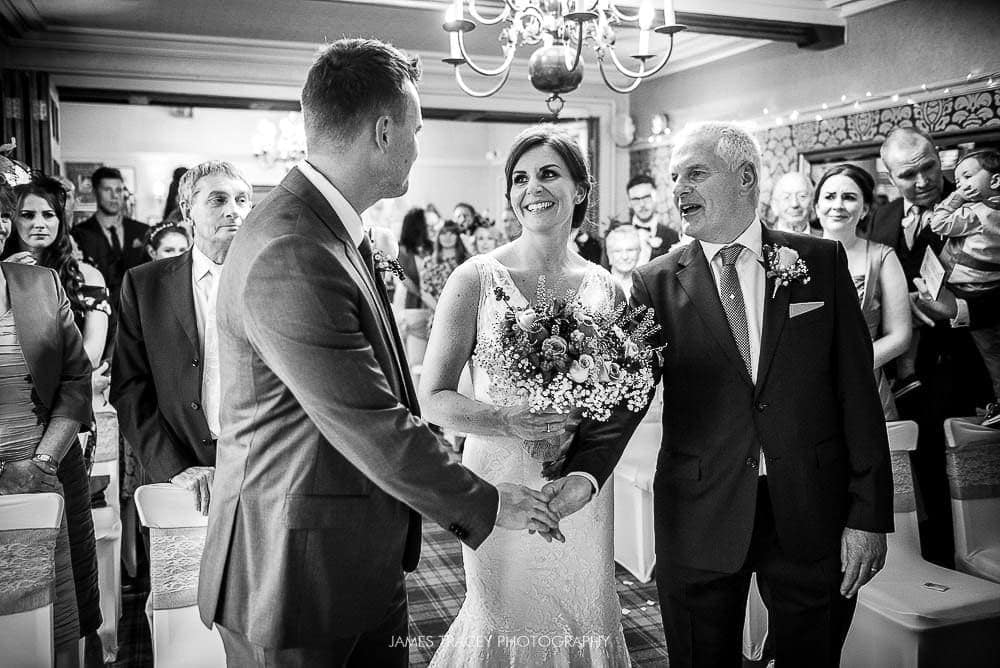 father of the bride shaking grooms hand