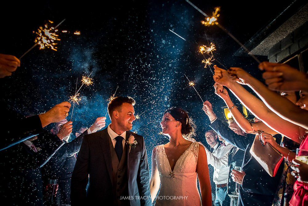 bride and groom in sparklers
