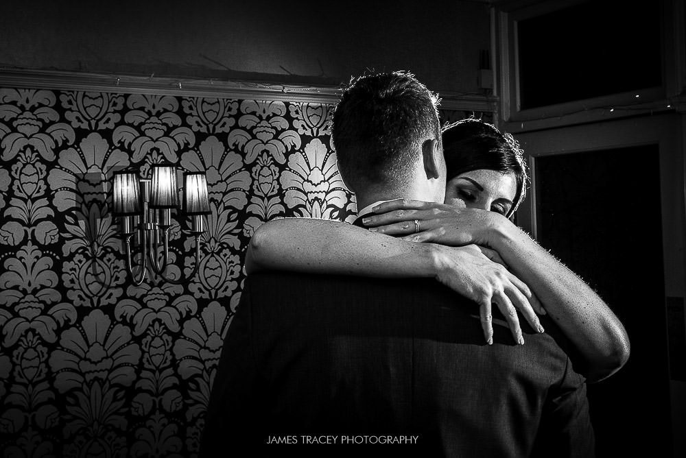 bride and groom hugging at broadoaks country house