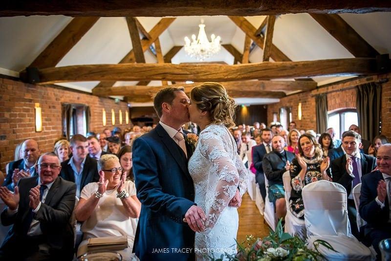 first wedding kiss at swancar farm wedding