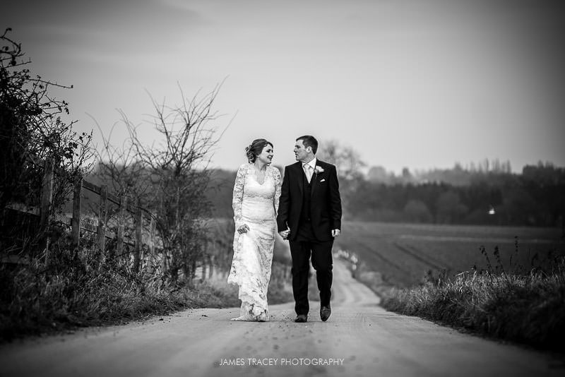 bride and groom walking at swancar farm