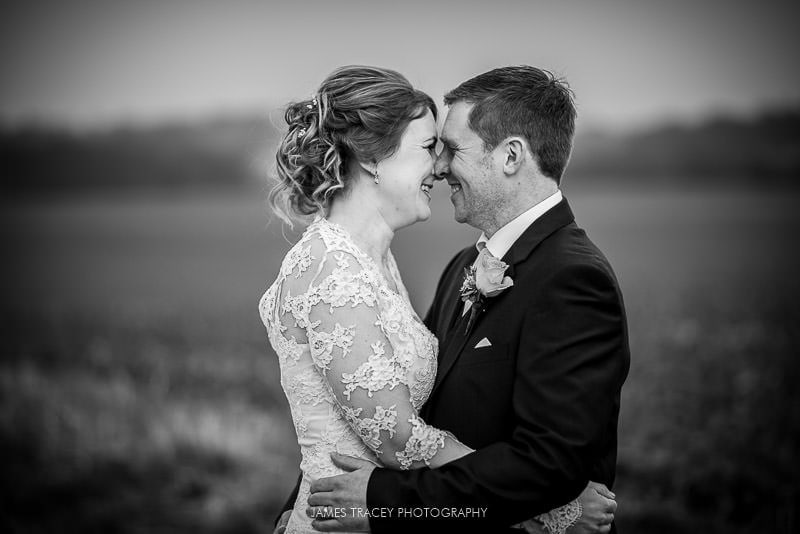 black and white photo of wedding couple at swancar farm