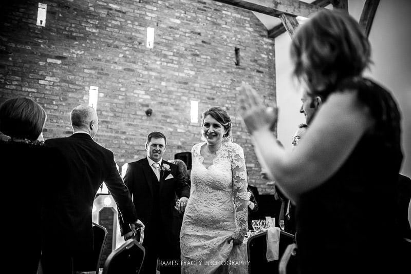 bride and groom walking into swancar farm