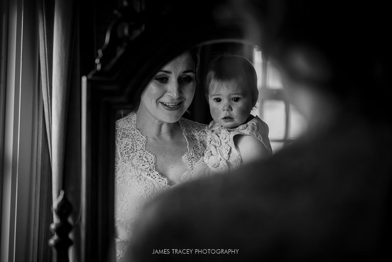 bride and daughter in a mirror