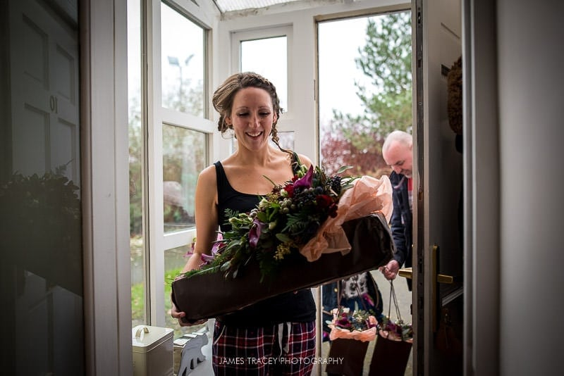 bride getting her wedding flowers