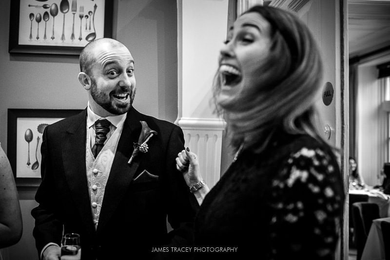 groom laughing with a wedding guest at woodlands hotel leeds