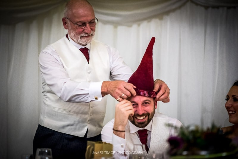 groom made to wear a daft hat
