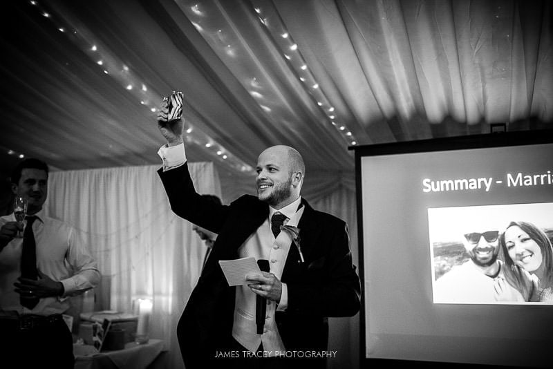 best man toasting wedding couple