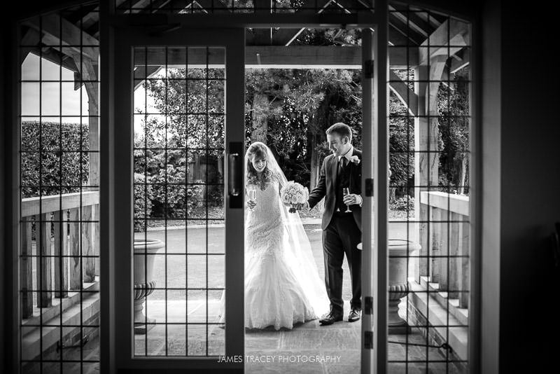 bride and groom walking into the pavillion at colshaw hall