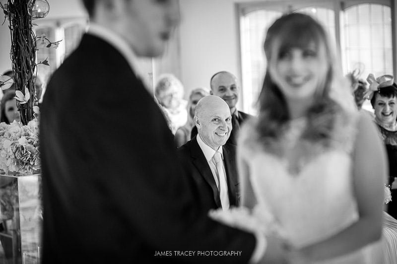 smiling father of the bride