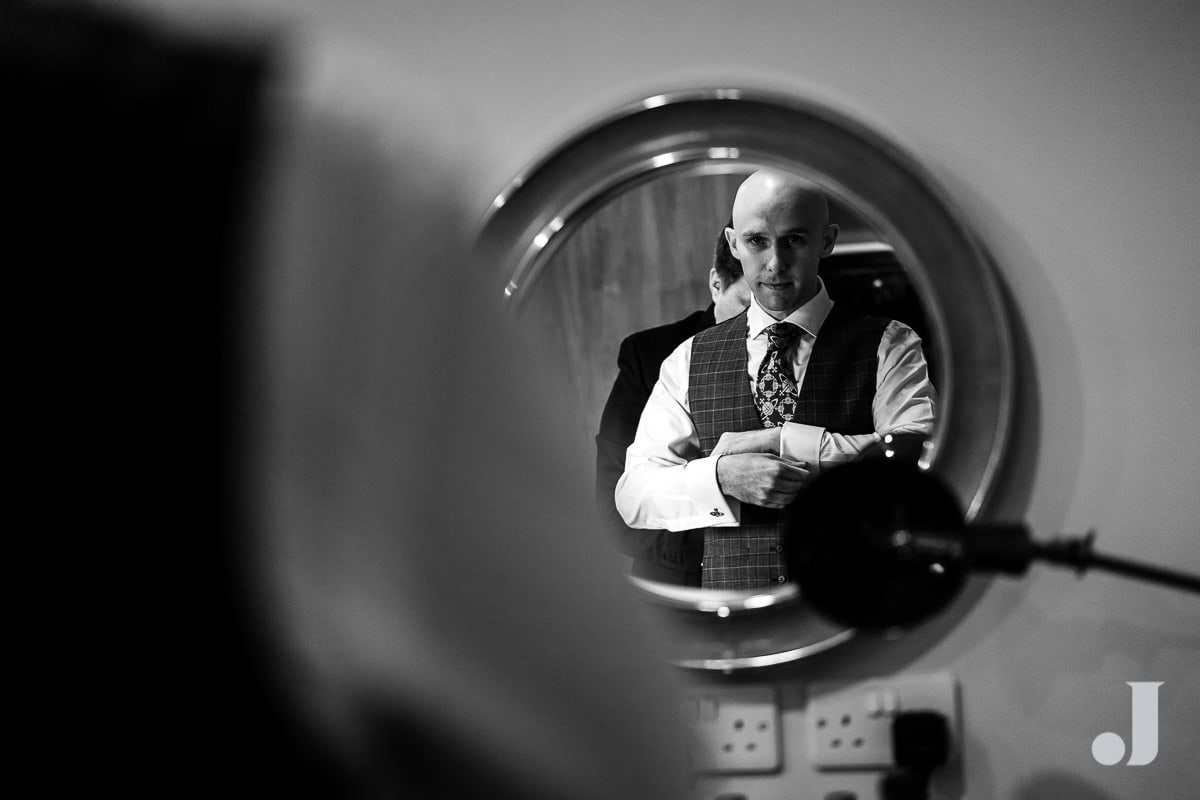 groom in a mirror
