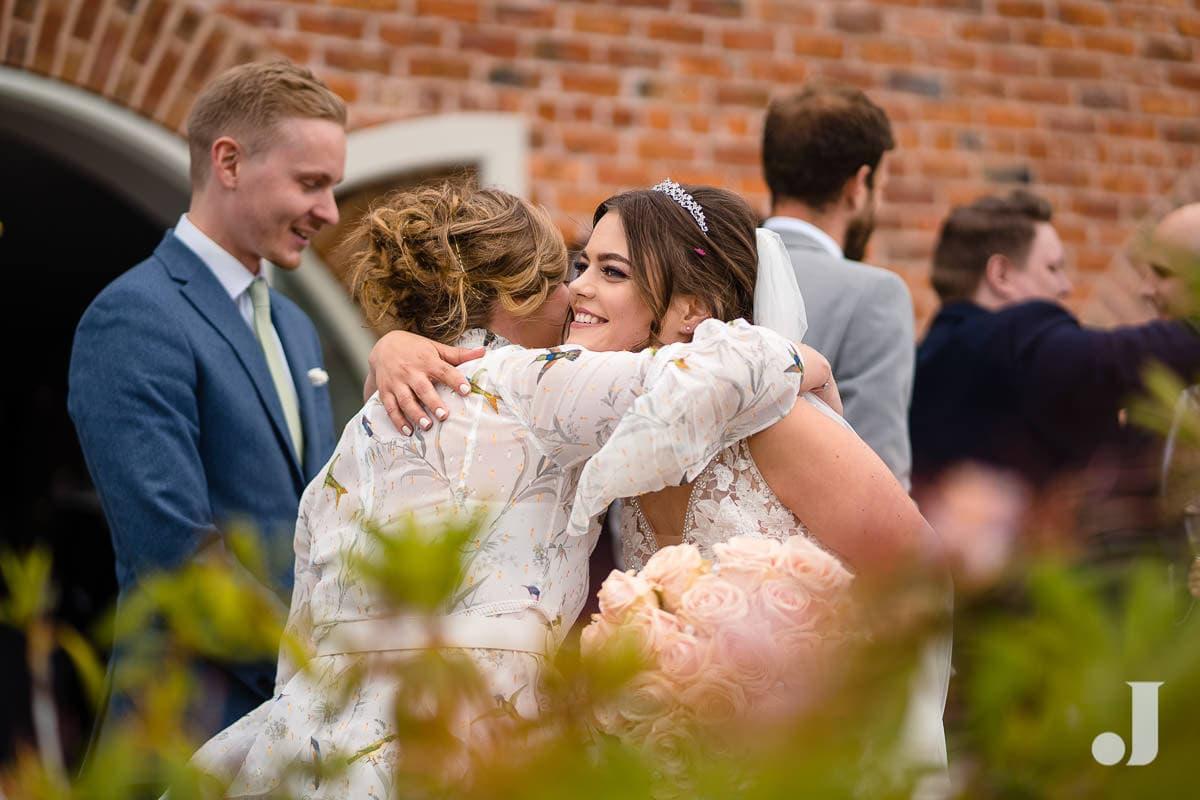 bried hugging guests