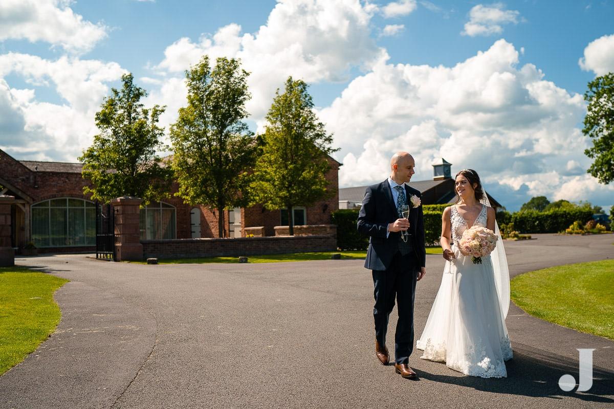 bride and groom walking outside merrydale manor