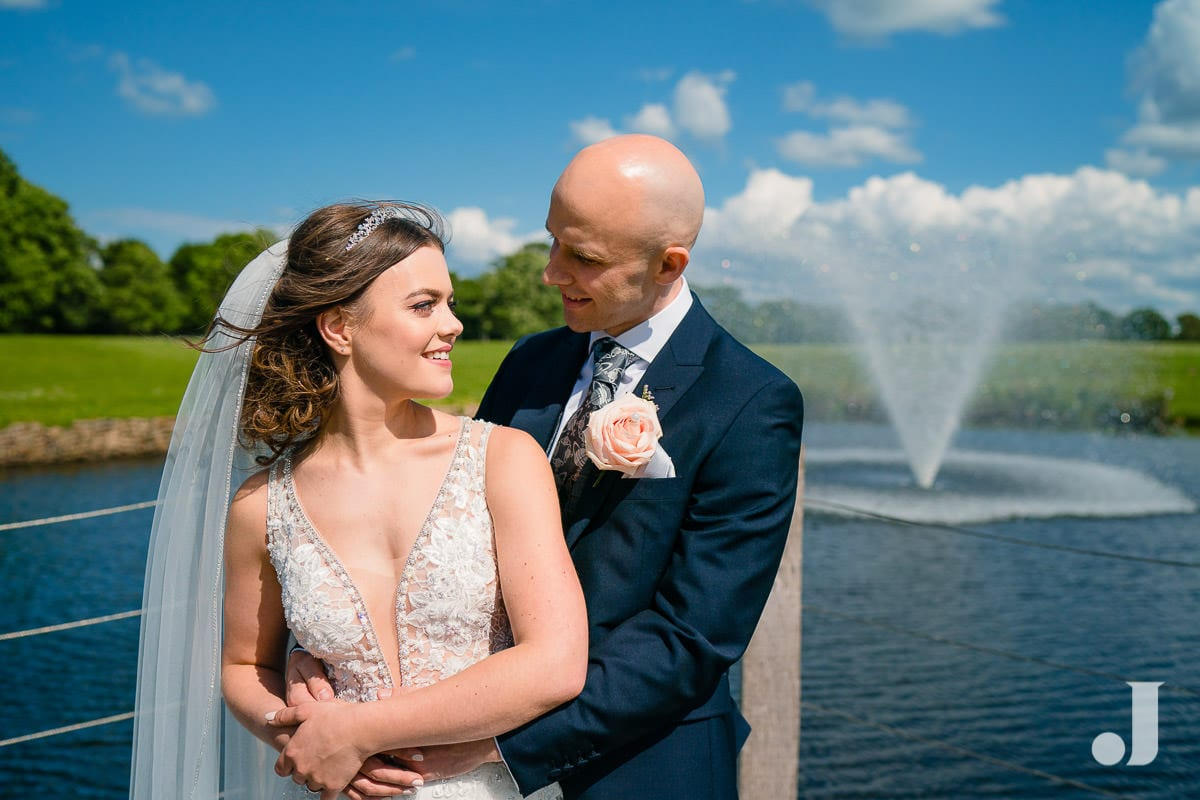 wedding couple at merrydale manor lake