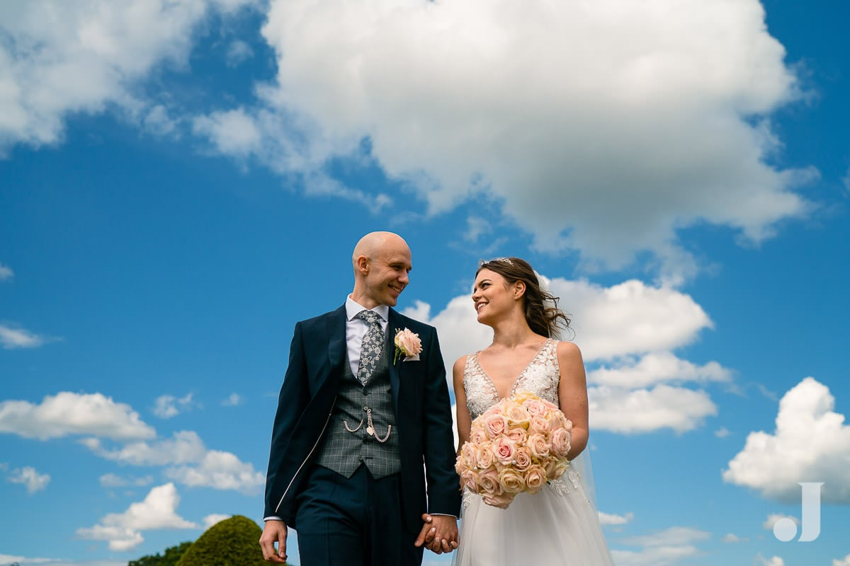 bride and groom and clouds