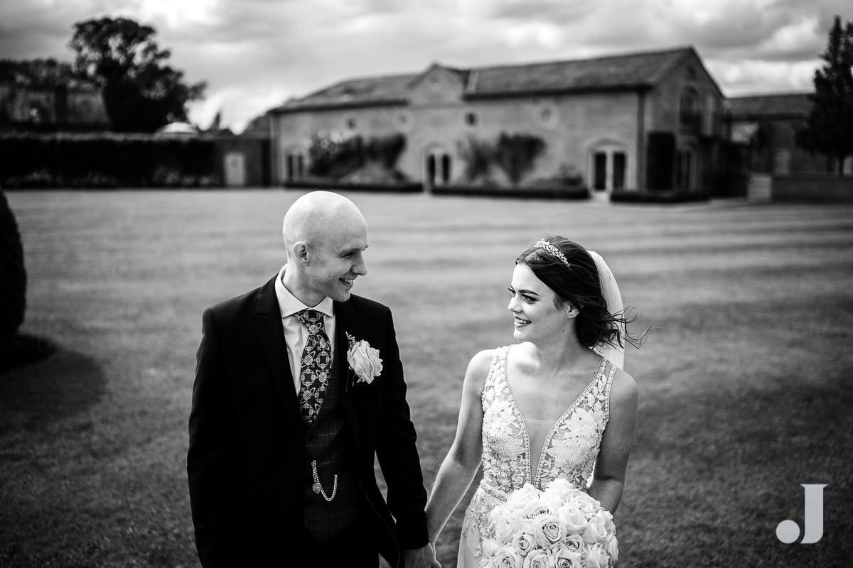 bride and groom walking in front of merrydale manor