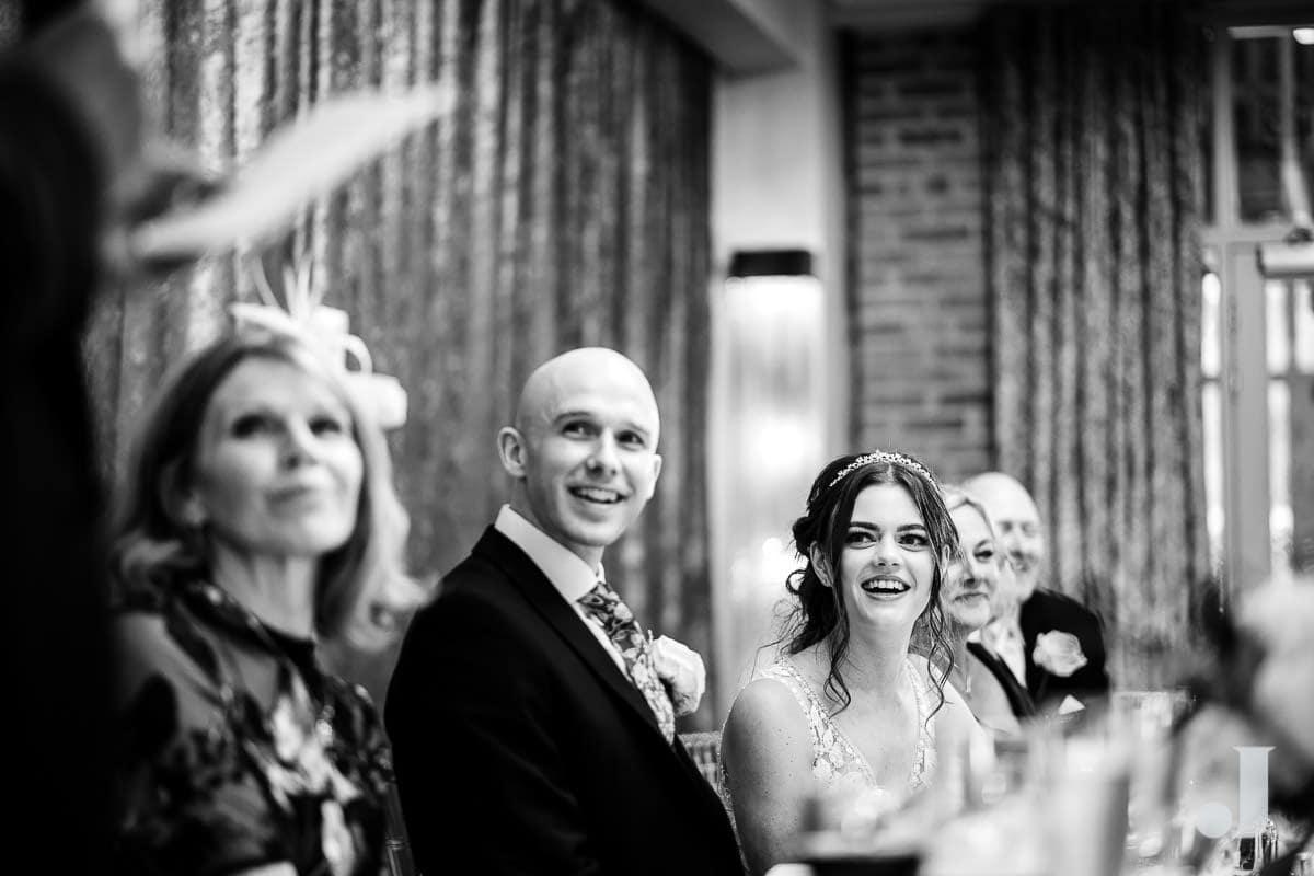 laughing wedding couple