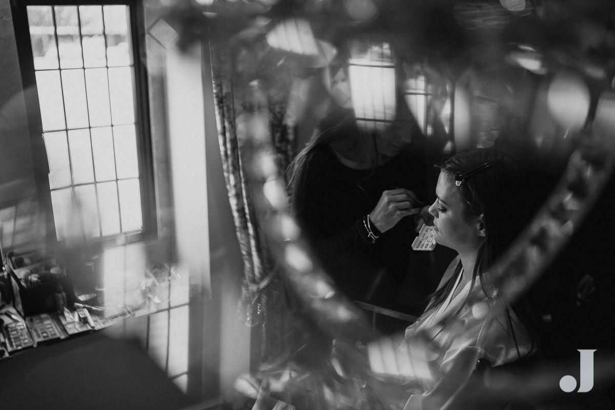 bride shot through chandelier