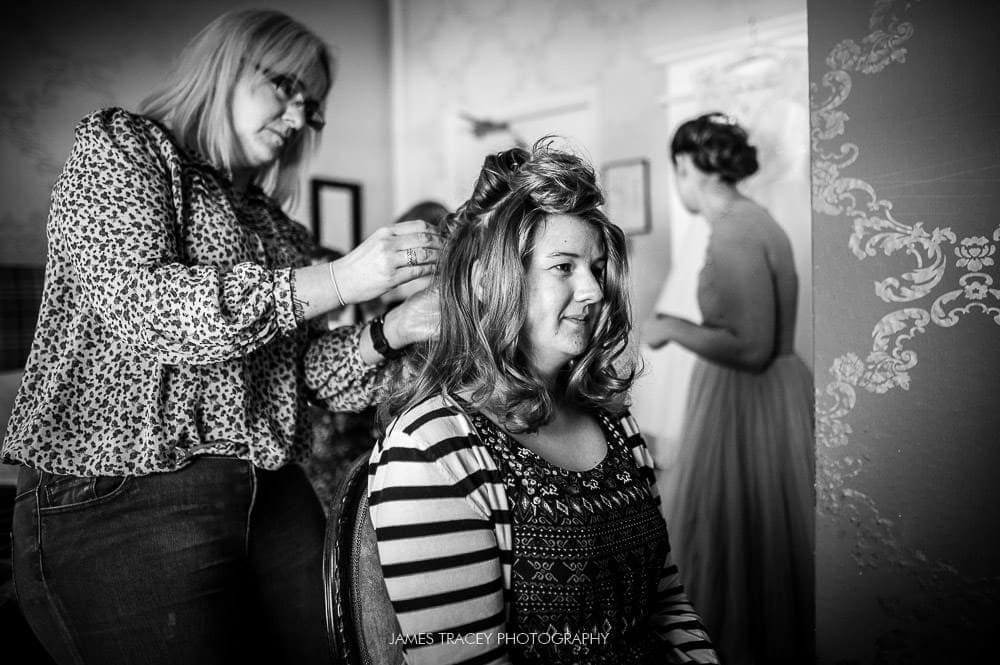 bride having hair set