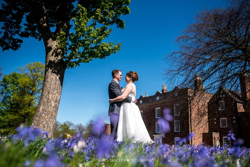 bride and groom in front of meols hall