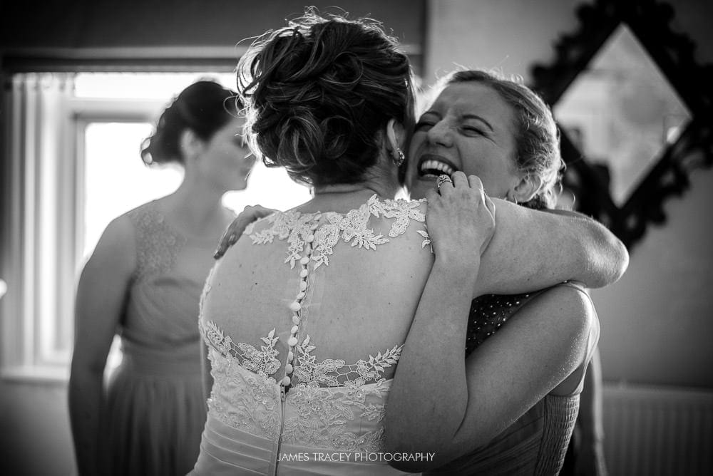 bride being hugged