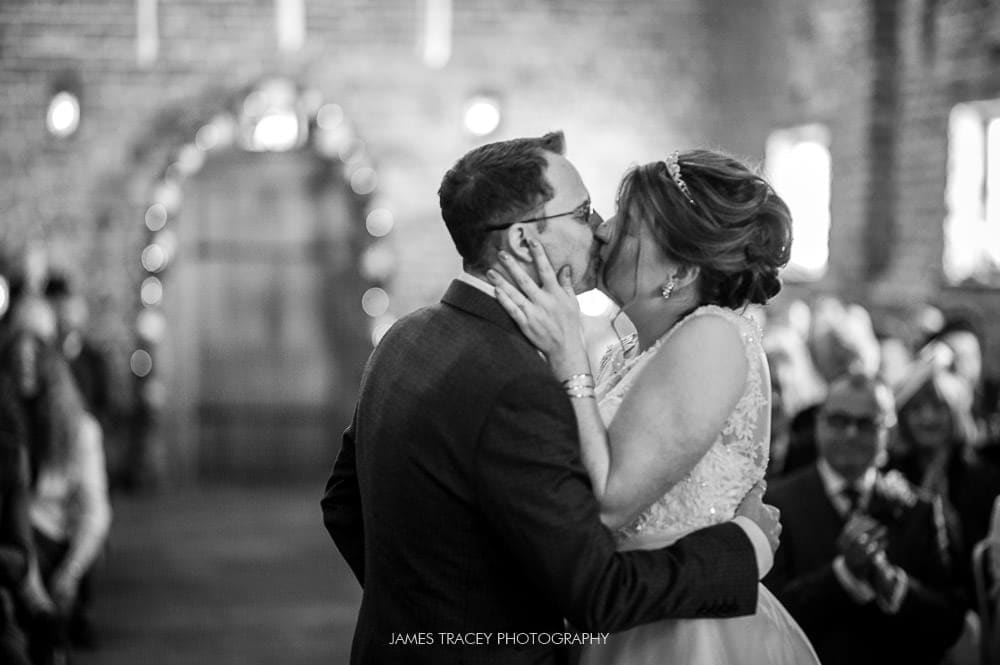bride and groom kissing at meols hall