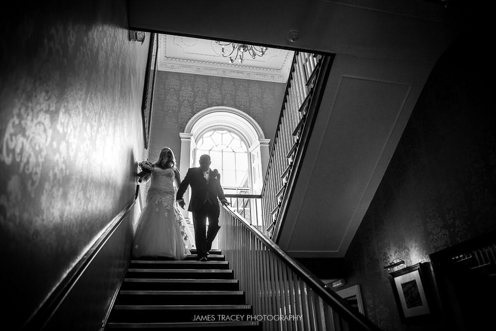 bride walking to her wedding at mottram hall