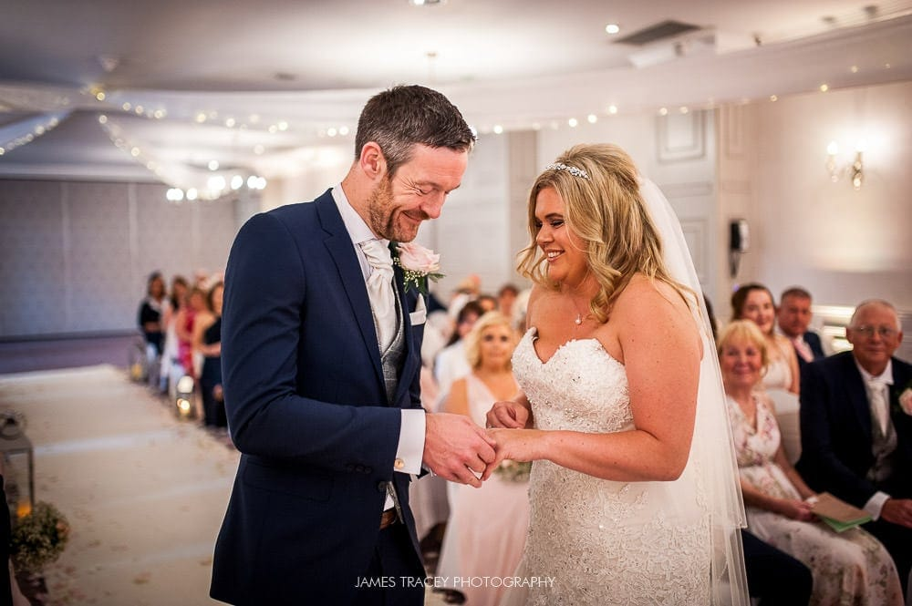 exchange of wedding rings at mottram hall
