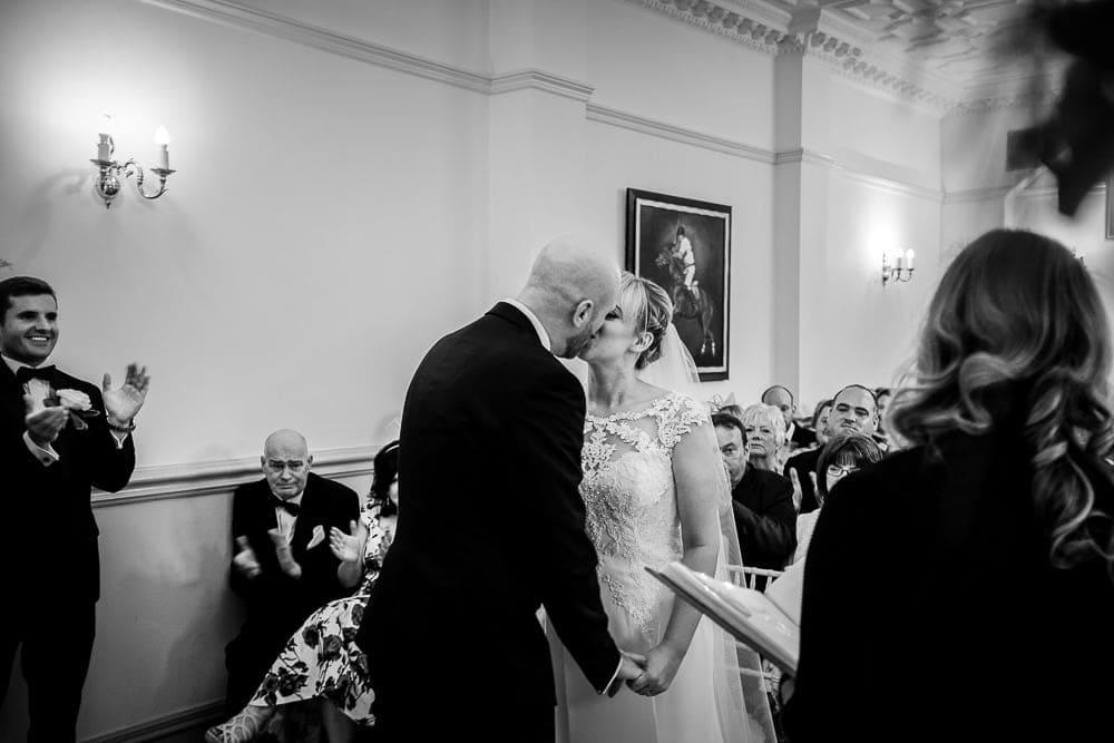 bride and groom kiss at nunsmere hall