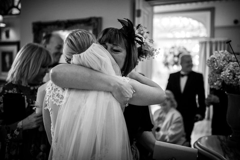 bride being hugged
