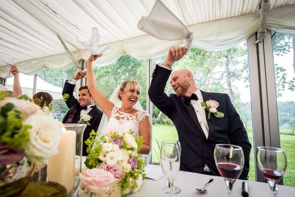 bride and groom enjoying singing waiters