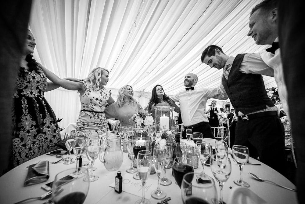wedding table enjoying singing waiters