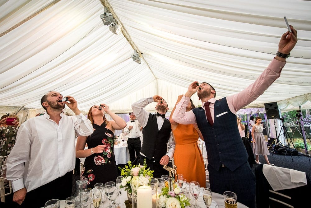 wedding guests downing jaeger