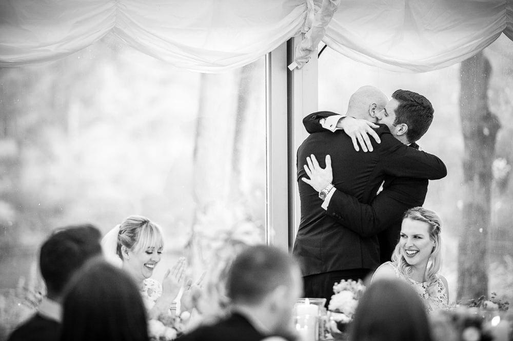 groom hugging his best man