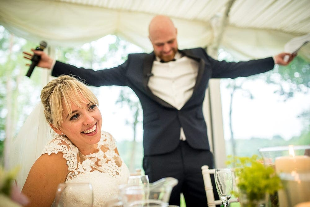 groom making bride laugh at nunsmere hall