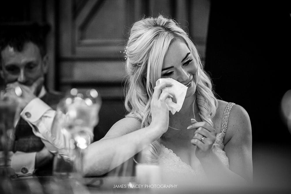 bride wiping a tear away