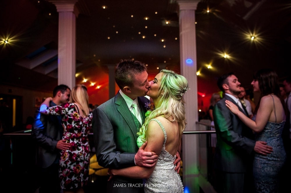 kissing at wedding dance