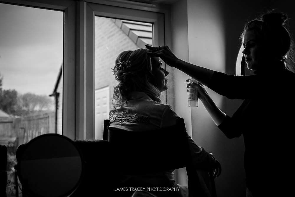 black and white shot of bridal prep