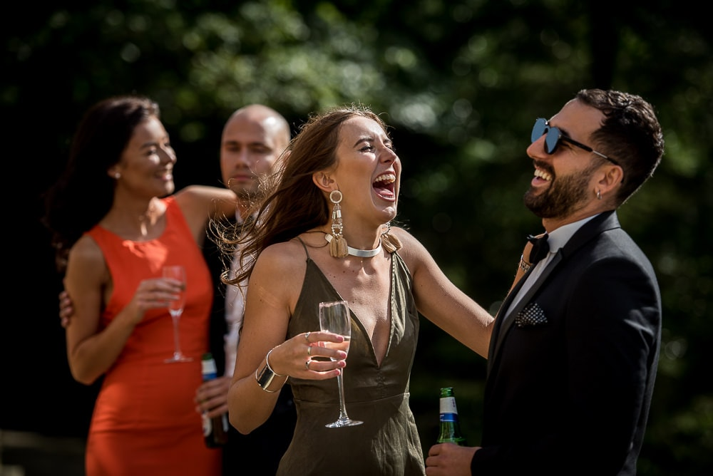 laughing wedding guests at upper house hayfield