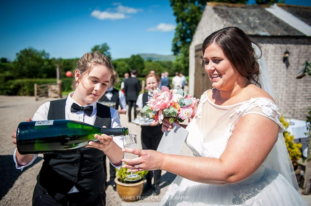 bride having champagne at eden wedding barn