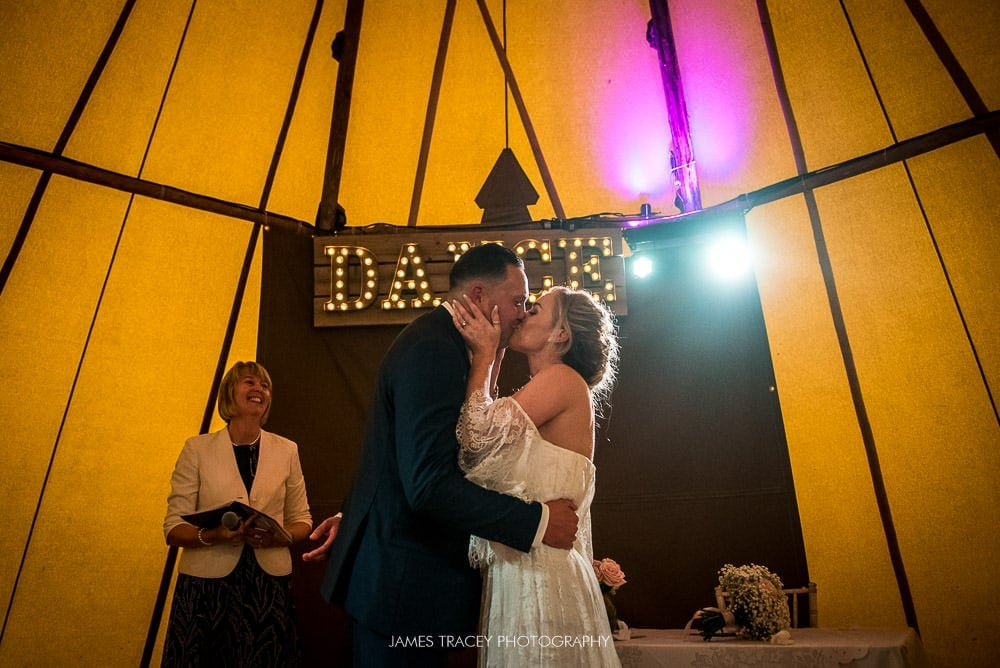 wedding kiss at hidden river cabin