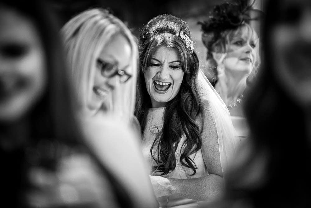bride laughing with wedding guests