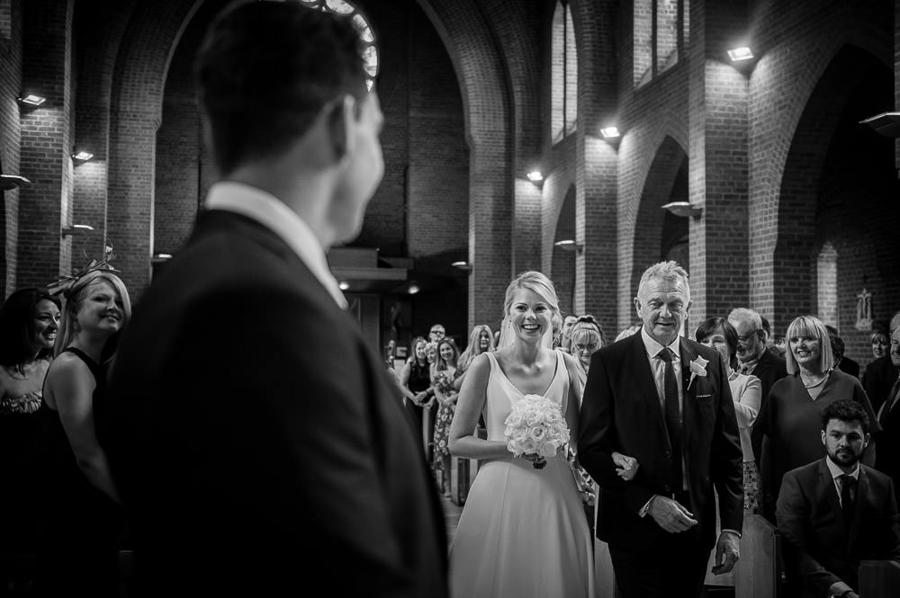 bride walking up the aisle in hale barns