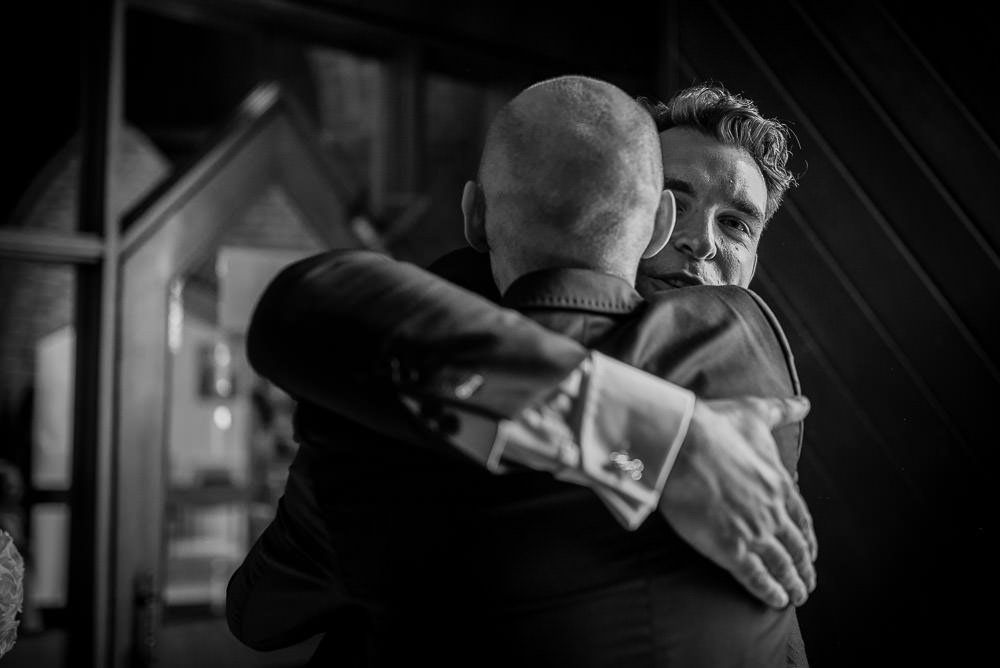 big hugs ata church wedding