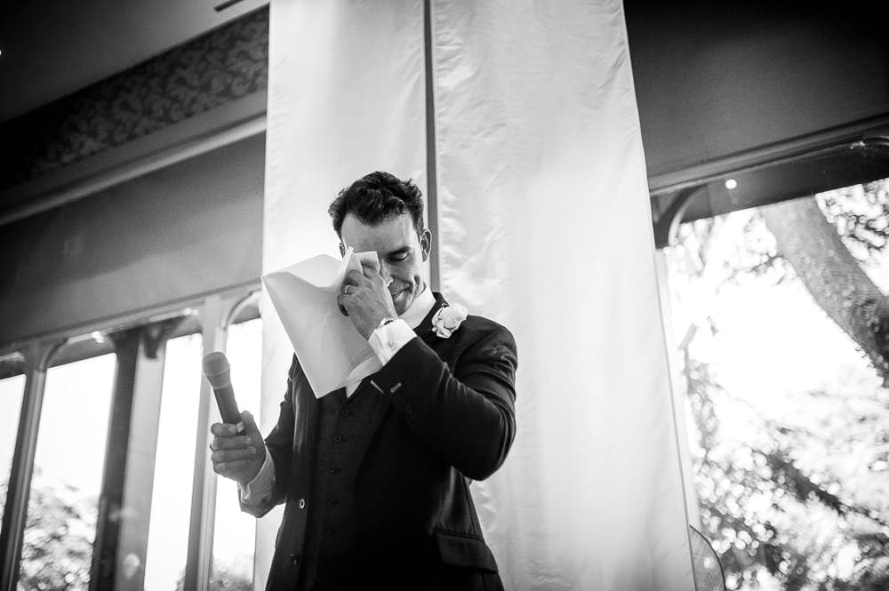 groom wiping tears from his eyes